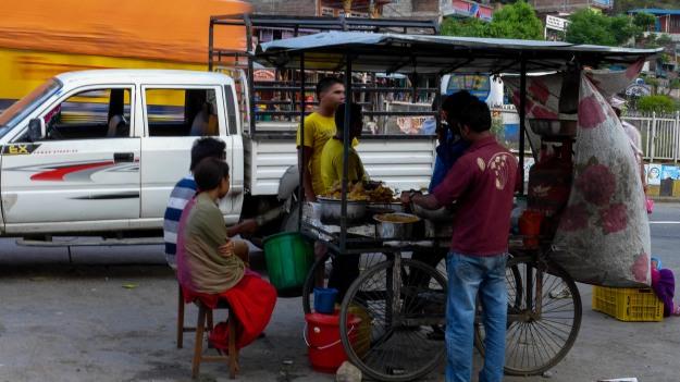 Roadside food stall near the river.